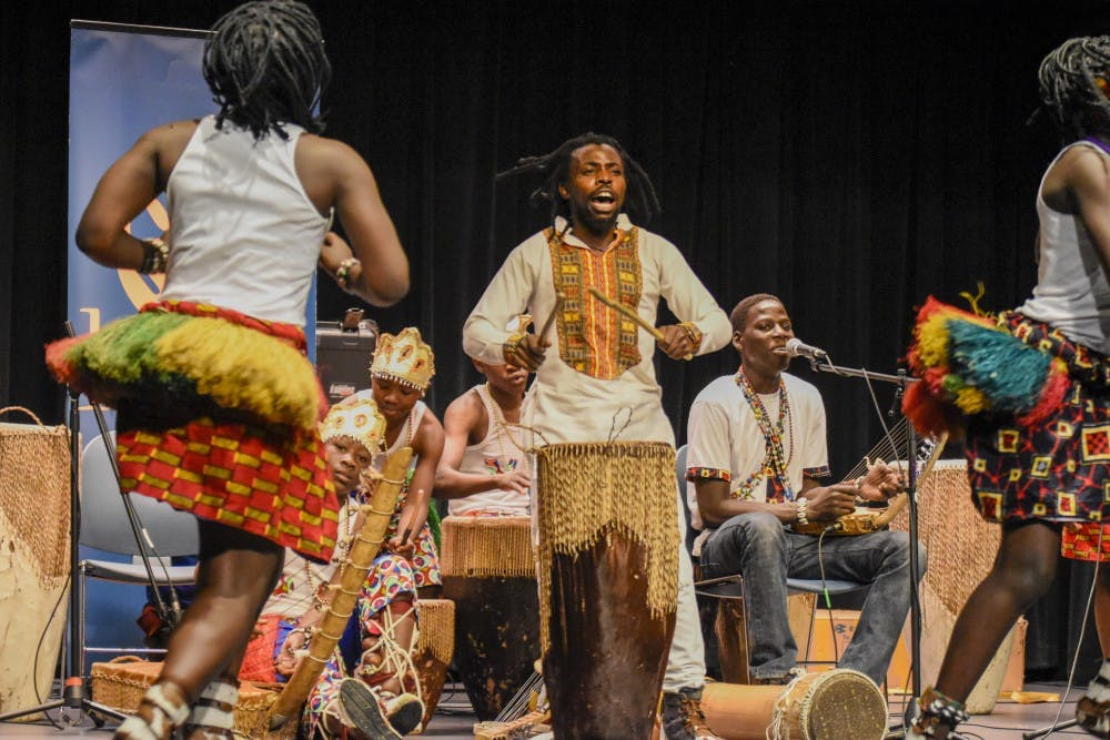 <p>Samuel Malangira leads the dancers and the band during a performance by Dance of Hope. The group performed as part of the Lotus Blossoms free public event series.</p>