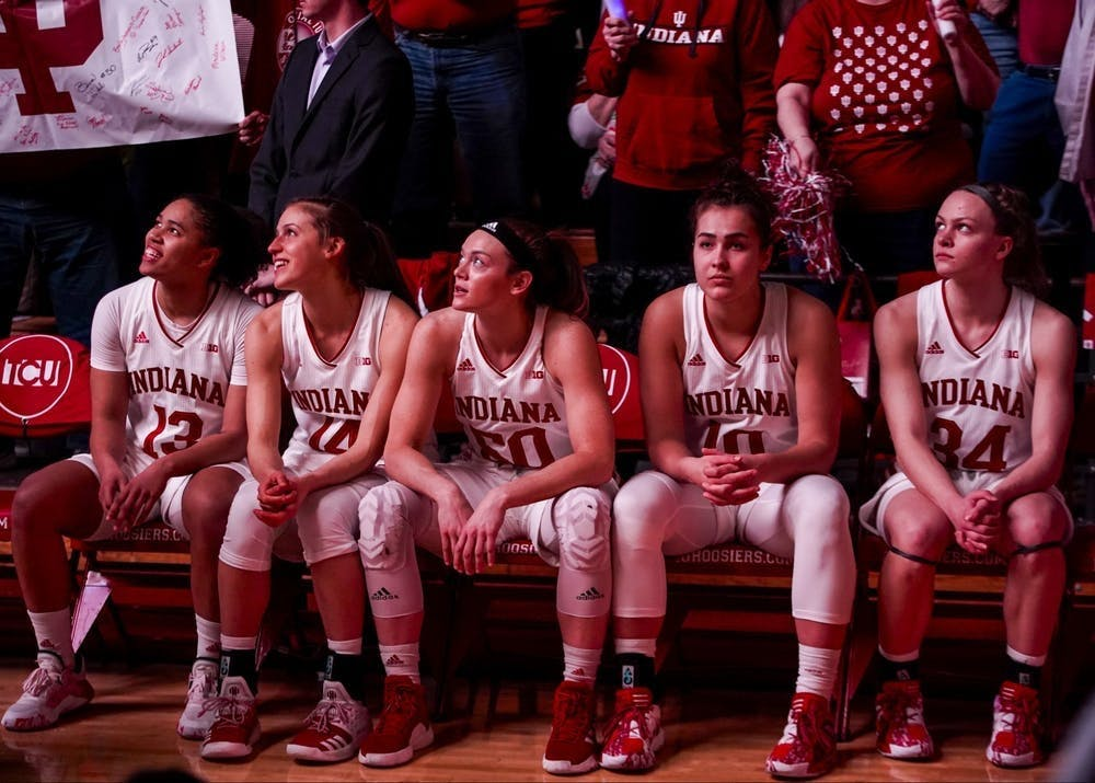 <p>IU women&#x27;s basketball&#x27;s then-starting lineup sits and watches a pregame video Feb. 16, 2020, in Simon Skjodt Assembly Hall.</p>