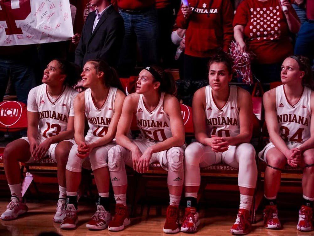 IU women's basketball's then-starting lineup sits and watches a pregame video Feb. 16, 2020, in Simon Skjodt Assembly Hall.