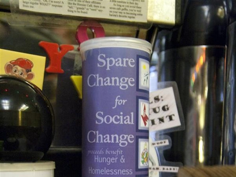 A Spare Change for Social Change container adorns the counter top Monday at Soma Coffee House. The Spare Change for Social Change is designed to raise money to help the homeless during Homeless and Hungry week.