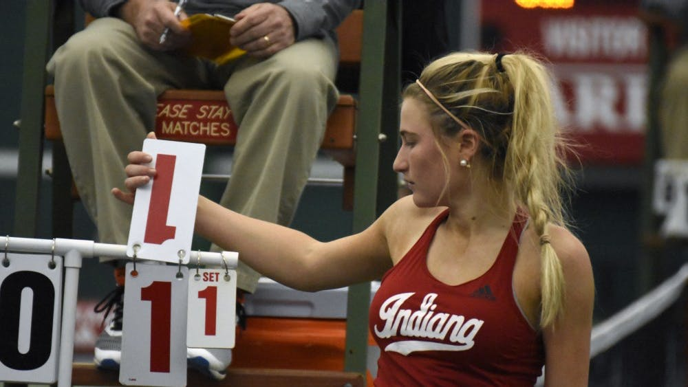 Junior Madison Appel flips her scorecard after winning a game in her 7-6, 6-1 singles win over Minnesota. Her win at the number one singles spot helped the Hoosiers to a 5-2 overall win.