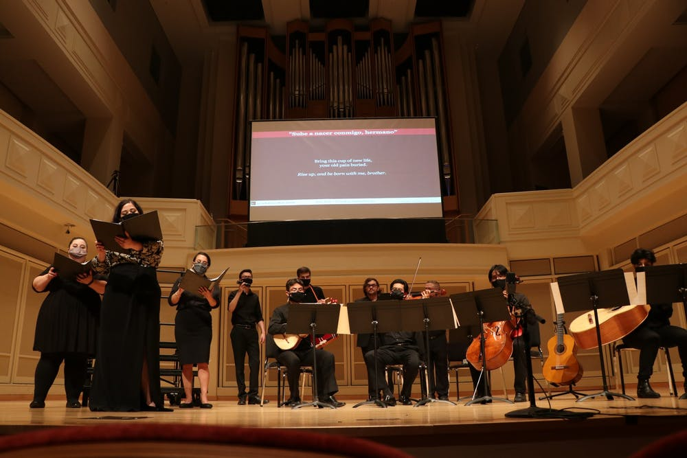 <p>Performers at the Latin American Music Center perform their second song &quot;Sube a Nacer Conmigo, Hermano&quot; on Sept. 30, 2021, at Auer Hall. The performance was a part of the Salón Latino Chamber Music Series: Cantata Popular Santa María De Iquique.</p>