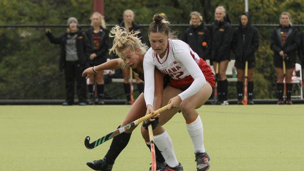 Now-senior forward Sheridan Weiss blocks Maryland player Hannah Bond from the ball Oct. 12 at the IU Field Hockey Complex. The IU field hockey team lost its season-opening match to No. 12 University of Louisville, 5-0.