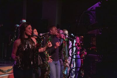 Members from Soul Revue perform Dec. 12 in the Willkie Residence Center Auditorium. The group performed popular Christmas songs written by black artists during their annual Soulful Holiday Concert.