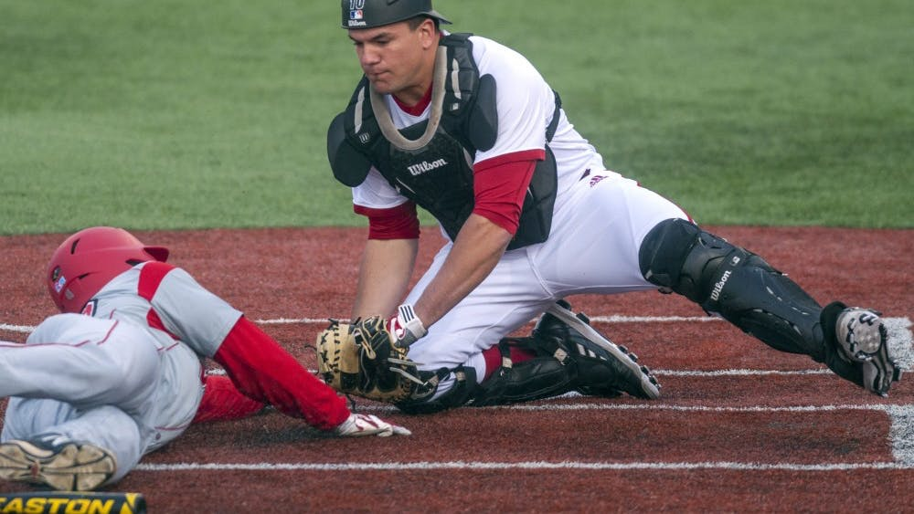 Then-junior Kyle Schwarber tags a player out at home plate during IU's game against Western Kentucky on April 16, 2014, at Bart Kaufman Field. Schwarber participated in the MLB Home Run Derby on Monday.