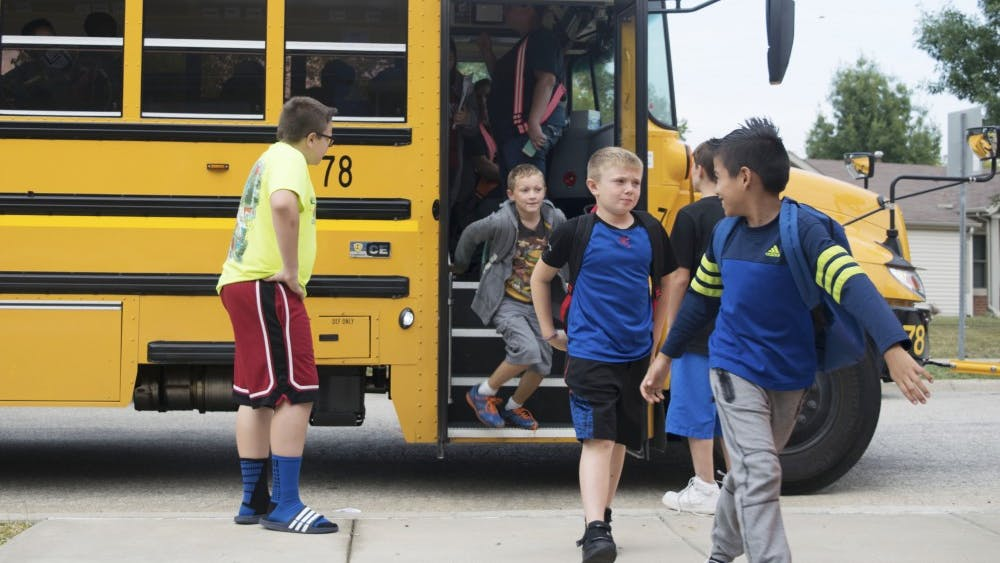 Students disembark a school bus at the Boys and Girls Crestmont Club after school in September. The Monroe County Community School Corporation officially terminated its contract with the Michigan-based Auxilio Services on Oct. 13 and moved to an in-house bus system.