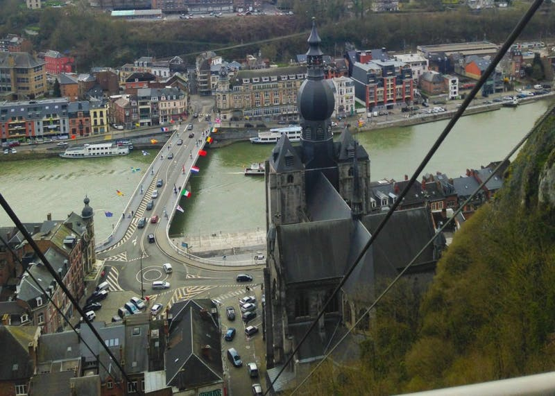 The Citadel of Dinant is a fortress located in the Walloon city of Dinant in the province of Namur, Belgium. The view from the top shows the city and the Meuse river.