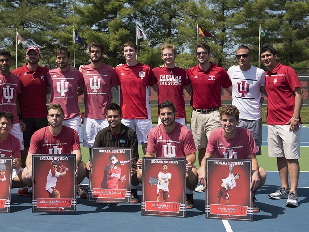 IU Men's Tennis seniors, bottom from left to right, Elliott Yee, Daniel Bednarczyk, Alekzander Davila, Sam Monette and Chris Essick are recognized for their contributions to the program on Sunday after the final home game of the season.