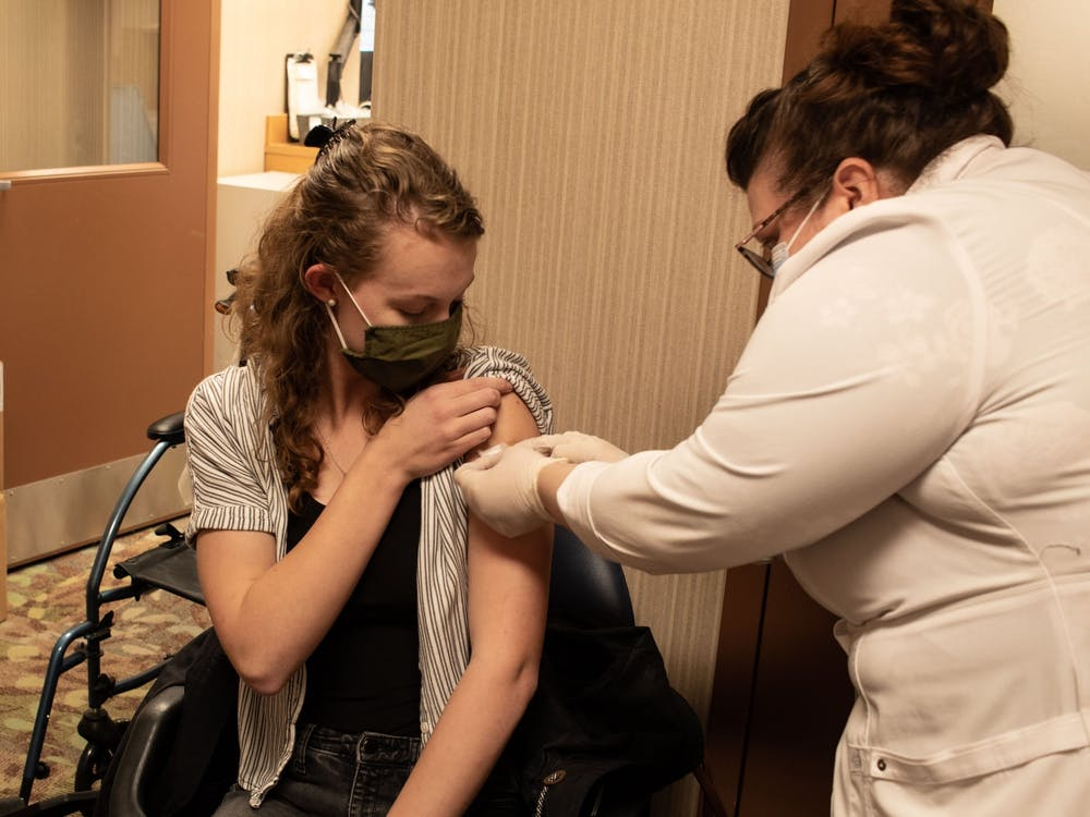 Sophomore Kathryn Mick receives the first round of the Pfizer vaccine Monday. Vaccines are free to all eligible residents, regardless of insurance, according to Healthline.