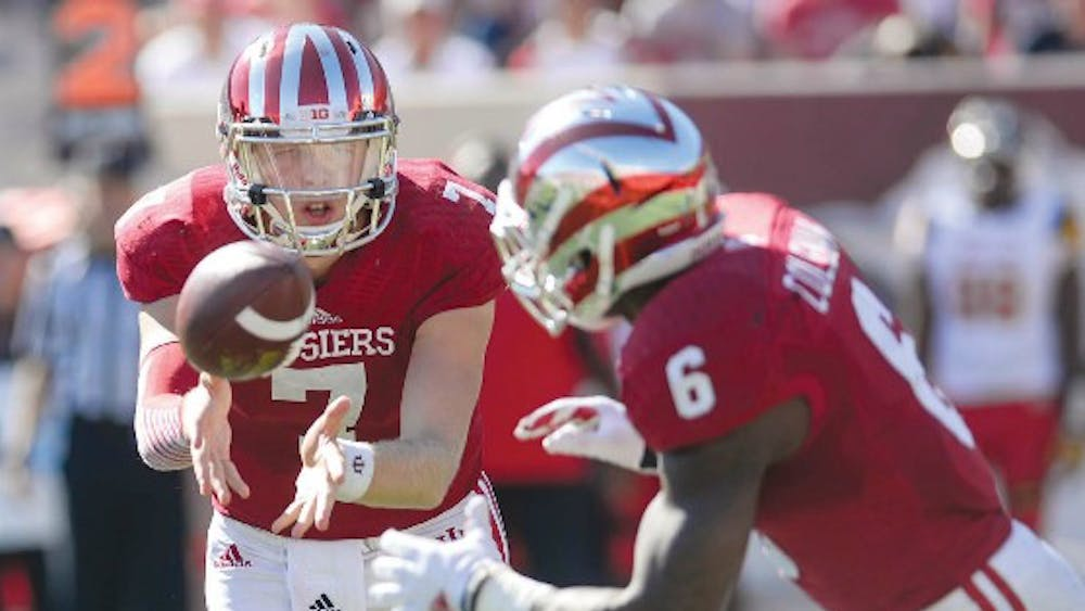 Junior quarterback Nate Sudfeld pitches the ball during an option play to junior runningback Tevin Coleman during IU's game against Maryland Sept. 27 at Memorial Stadium.