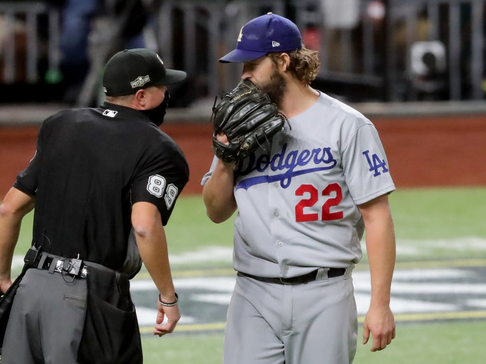 Los Angeles Dodgers starting pitcher Clayton Kershaw talks with the home plate umpire after the first inning against the Atlanta Braves in Game 4 of the National League Championship Series on Oct. 15 at Globe Life Field in Arlington, Texas.
