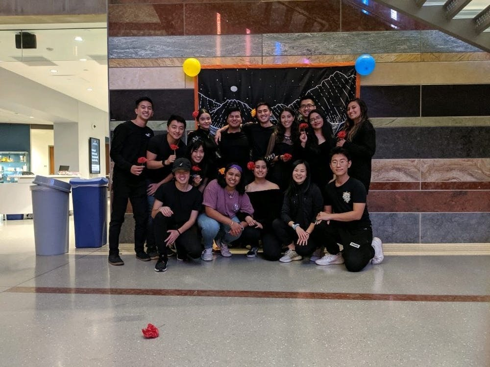 Latinos Unidos at IU members and Asian American Association members pose for a photo in fall 2019 at the Hamilton Lugar School of Global and International Studies. Latinos Unidos at IU taught Asian American Association members more about the traditions of Día de Los Muertos.