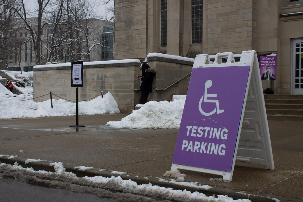 <p>A sign showing where accessible mitigation testing parking is sits Feb. 9 outside the IU Auditorium. Some students say they walk up to half an hour to get to their testing location.</p>