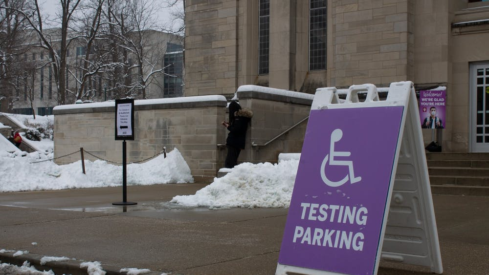 A sign showing where accessible mitigation testing parking is sits Feb. 9 outside the IU Auditorium. Some students say they walk up to half an hour to get to their testing location.