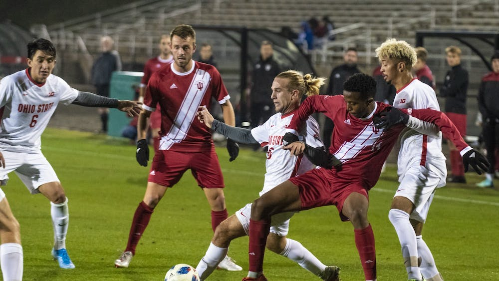 Freshman Maouloune Goumballe tries to keep possession of the ball under pressure from several Ohio State defenders Oct. 29 at Bill Armstrong Stadium. IU's final regular season match is against Michigan State in East Lansing, Michigan.