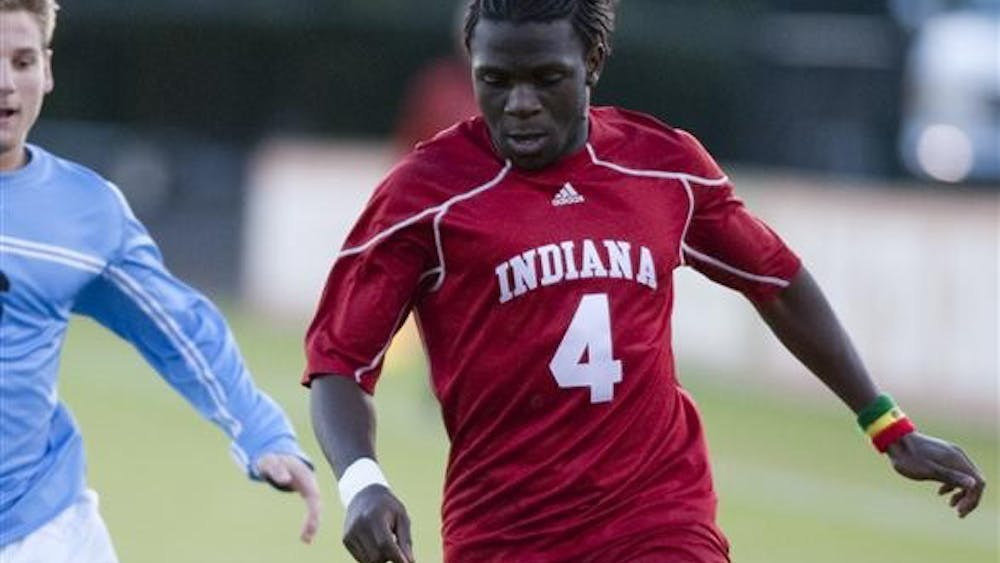 Ofori Sarkodie dribbles the ball downfield against a Butler defender Wednesday, Oct. 7 at Bill Armstrong Stadium.