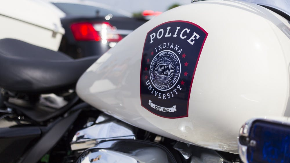 "The IU Police Department crest can be seen on the gas tank of one of the  IUPD motorcycles at the ""Touch a Truck"" event Monday in the Chick-fil-A parking lot at 3020 E. Third St."