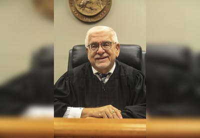 Judge Marc Kellams sits in the courtroom at the Justice Building. Kellams joined the Monroe county court in 1981.