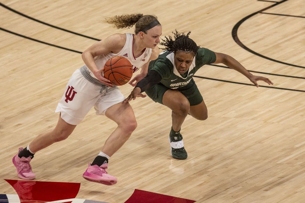 Junior guard Grace Berger dribbles around a defender March 11 in the quarterfinals of the Big Ten women's basketball tournament at Bankers Life Fieldhouse in Indianapolis. Berger was named one of IU's Athletes of the Year on Thursday.