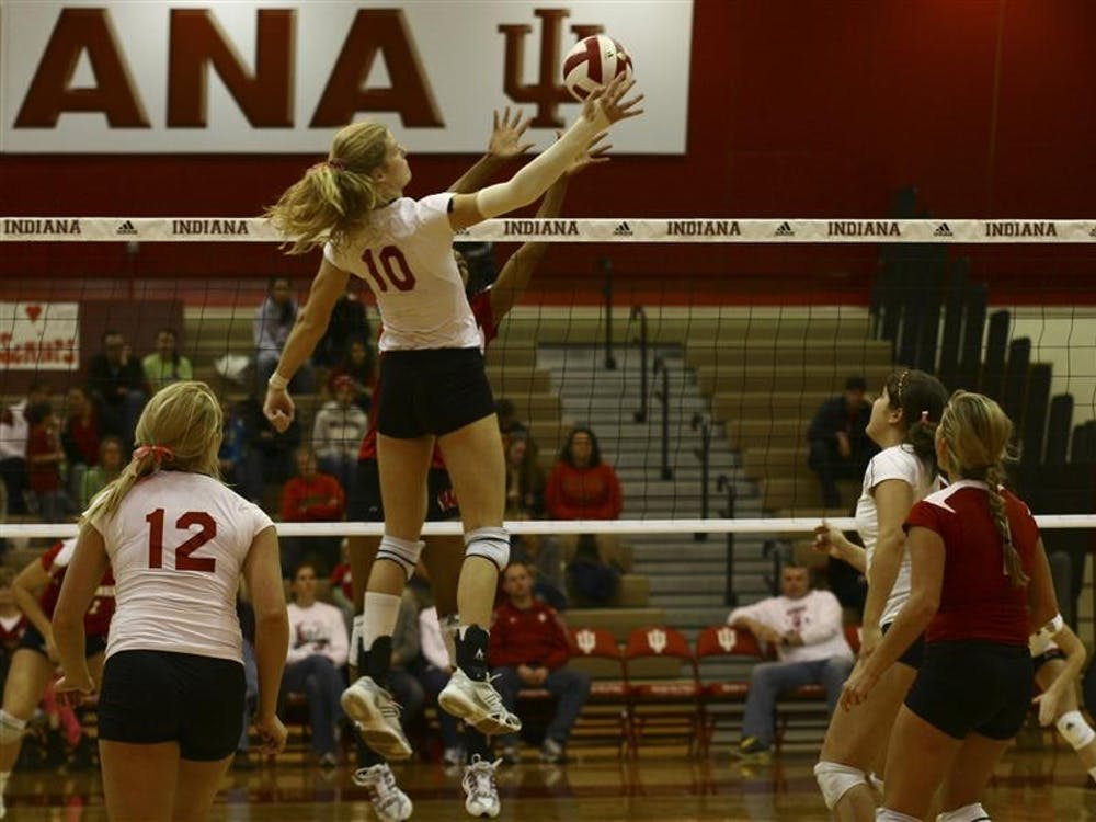 Senior Ashley Benson goes up for a kill Saturday in University Gym.  Benson was honored during the senior night celebrations as the best IU Volleyball player on record.