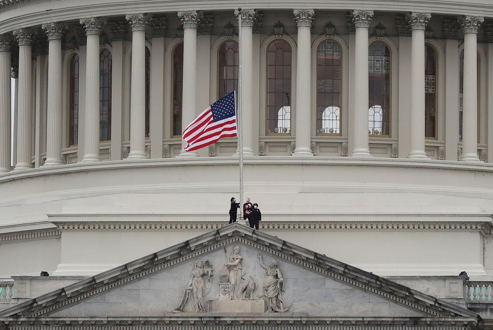 <p>The American flag at the U.S. Capitol is lowered to half-staff in remembrance of U.S. Capitol Police Officer Brian Sicknick on Jan. 8 in Washington D.C. Sicknick died from injuries caused by Pro-Trump supporters storming the Capitol. </p><p></p>