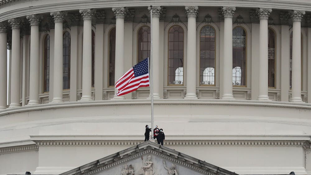 The American flag at the U.S. Capitol is lowered to half-staff in remembrance of U.S. Capitol Police Officer Brian Sicknick on Jan. 8 in Washington D.C. Sicknick died from injuries caused by Pro-Trump supporters storming the Capitol.