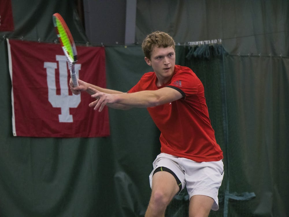 IU sophomore Carson Haskins prepares to hit the ball against the University of Notre Dame on Feb. 1 at the IU Tennis Center. IU will play University of California, Santa Barbara and Xavier University Feb. 17 in Bloomington.