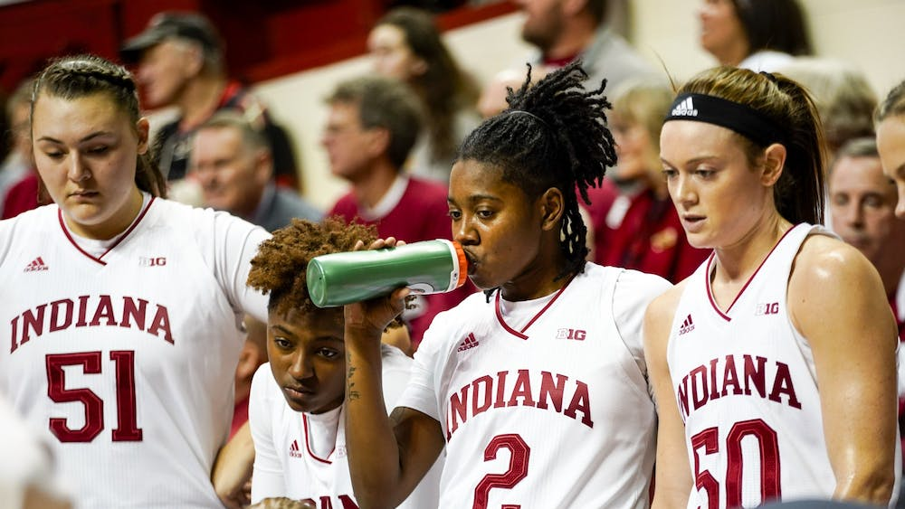 Junior Keyanna Warthen takes a drink and focuses on her coaches Feb. 6 in Simon Skjodt Assembly Hall. IU led during the first half but fell behind to Maryland, losing 69-79.