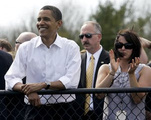 Then-Sen. Barack Obama watches pace laps with IU Student Foundation director Jenny Bruffey before the start of the women's Little 500 bicycle race in 2008 at Bill Armstrong Stadium. Obama walked around the track and greeted each team before the race.
