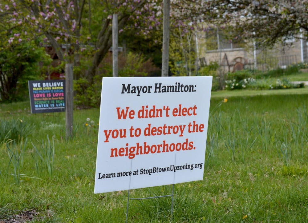 <p>A sign near Bryan Park reads &quot;Mayor Hamilton: We didn&#x27;t elect you to destroy the neighborhoods.&quot; The Bloomington City Council voted down a proposed amendment Tuesdayrejecting thePlan Commission'srecommendationto allow duplexes in single-family home neighborhoods.</p>