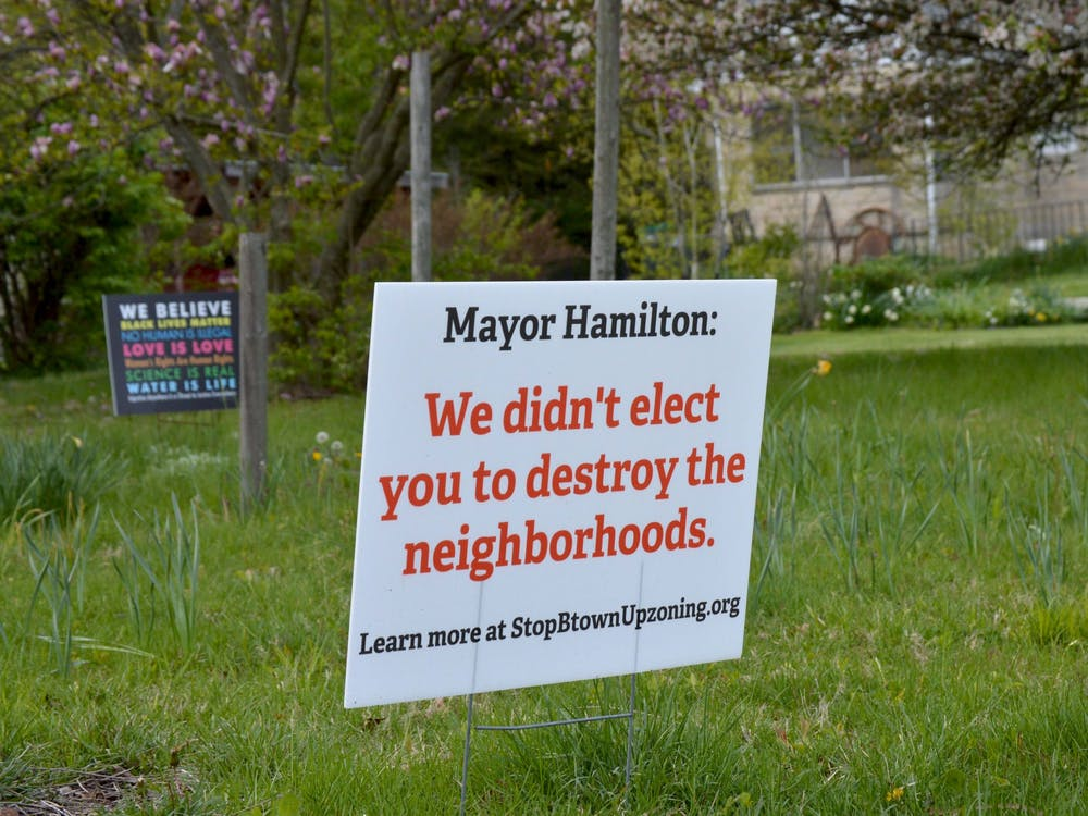 """A sign near Bryan Park reads """"Mayor Hamilton: We didn't elect you to destroy the neighborhoods."""" The Bloomington City Council voted down a proposed amendment Tuesdayrejecting thePlan Commission'srecommendationto allow duplexes in single-family home neighborhoods."""