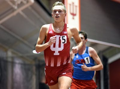 Redshirt sophomore Ben Veatch competes in the 5000 meter run at the Hoosier Open on Friday evening at Harry Gladstein Fieldhouse. Veatch beat out teammate junior Kyle Mau in the 3,000-meter and earned second in the 5,000-meter at the Big Ten Championships.