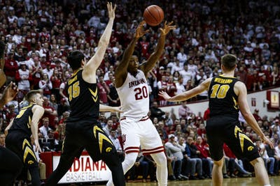 Junior forward De'Ron Davis passes the ball against Iowa on Feb. 7 at Simon Skjodt Assembly Hall. IU lost to Iowa, 77-72.