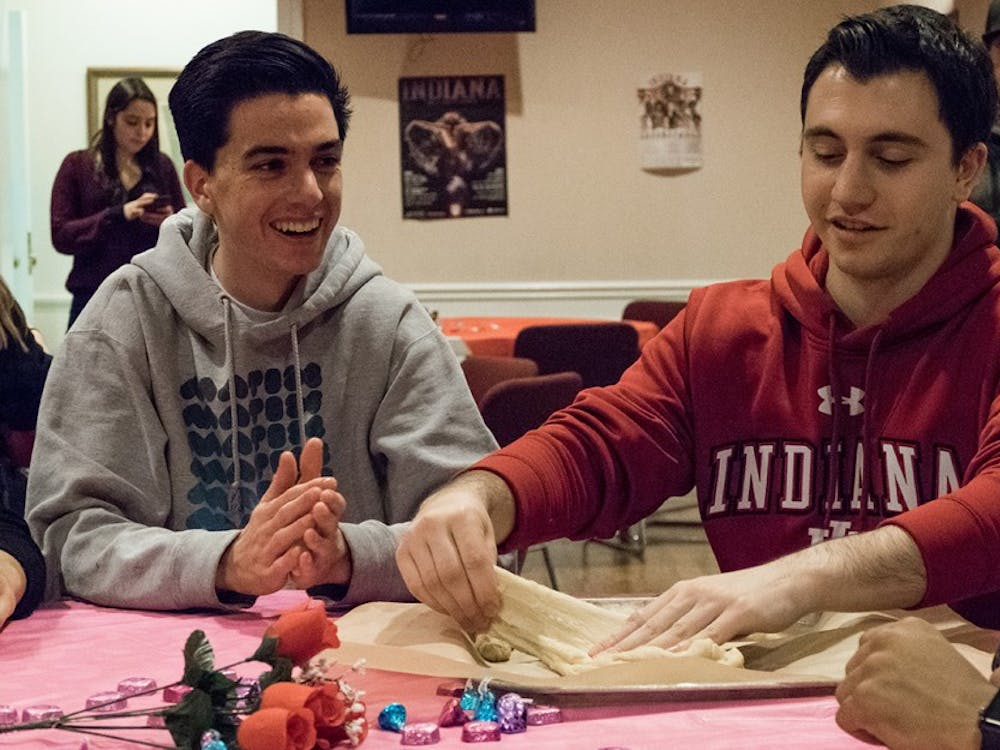 Freshmen Eban Stern (left) and Jake Trachtenberg prepare challah dough at the Hillel on Monday.  The Hillel hosted a challah baking event aimed towards raising breast cancer awareness.