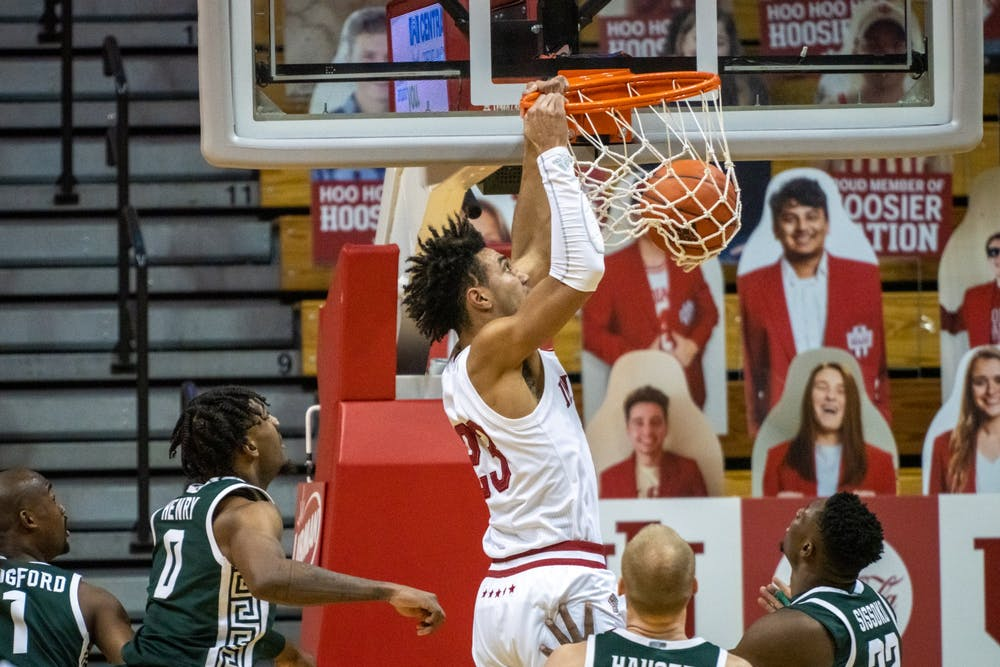 <p>Sophomore forward Trayce Jackson-Davis slam dunks Saturday at Simon Skjodt Assembly Hall. Jackson-Davis finished the game with 34 points and nine rebounds.</p>