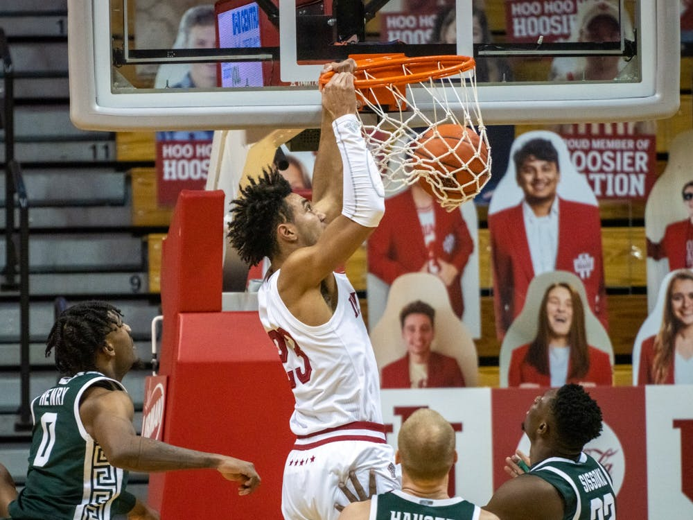 Sophomore forward Trayce Jackson-Davis slam dunks Saturday at Simon Skjodt Assembly Hall. Jackson-Davis finished the game with 34 points and nine rebounds.