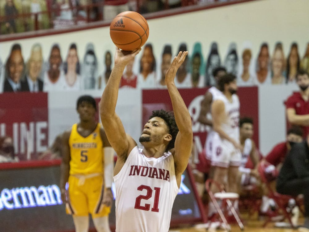 Redshirt sophomore Jerome Hunter shoots a free throw Feb. 17 in Simon Skjodt Assembly Hall. IU trailed  Minnesota 35-37at halftime.