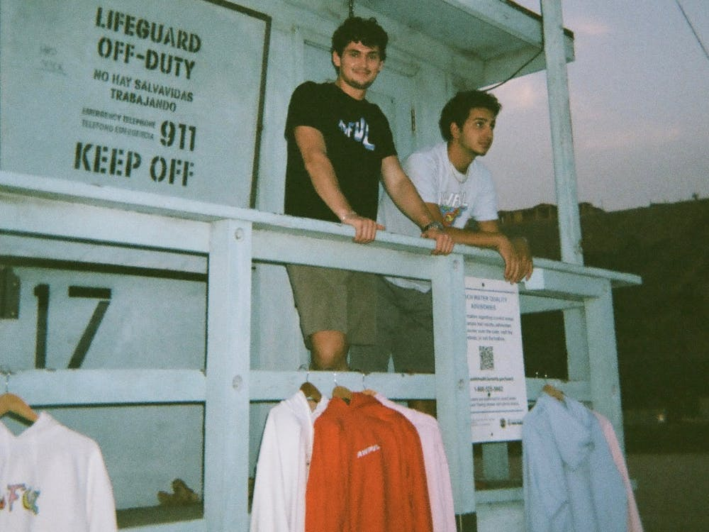 Awful Cloth co-creators, Fordham University senior Emmitt Flynn and IU senior Charles Zayed, pose with their clothing in October 2020 in Santa Monica, California.