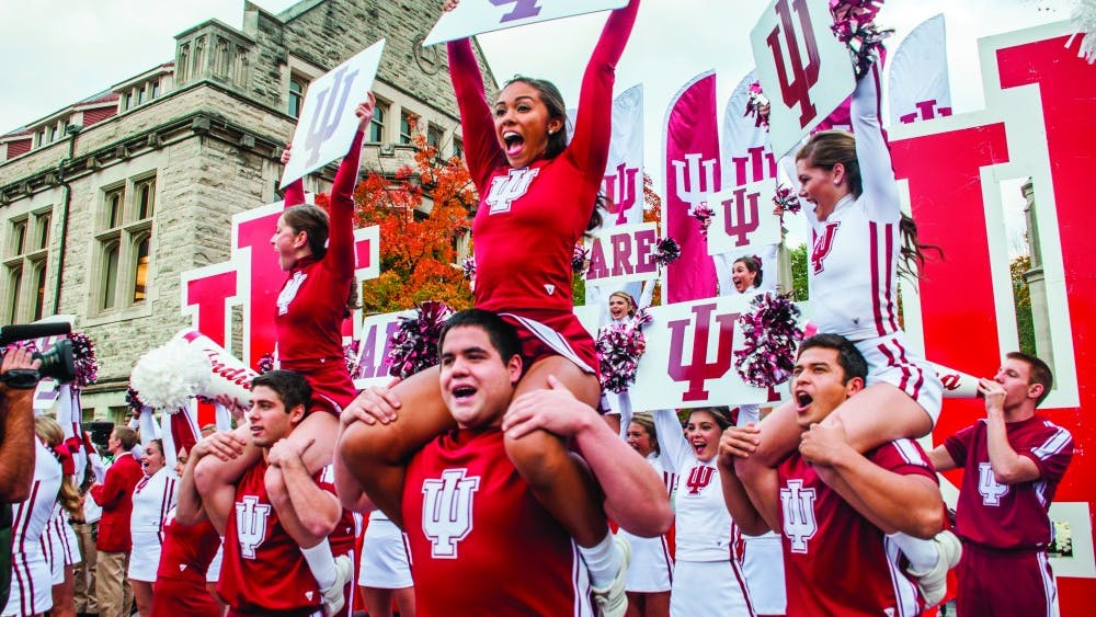 Kylie CisneyCheerleaders rally in front of the Sample Gates during the Oct. 17, 2014 homecoming parade.