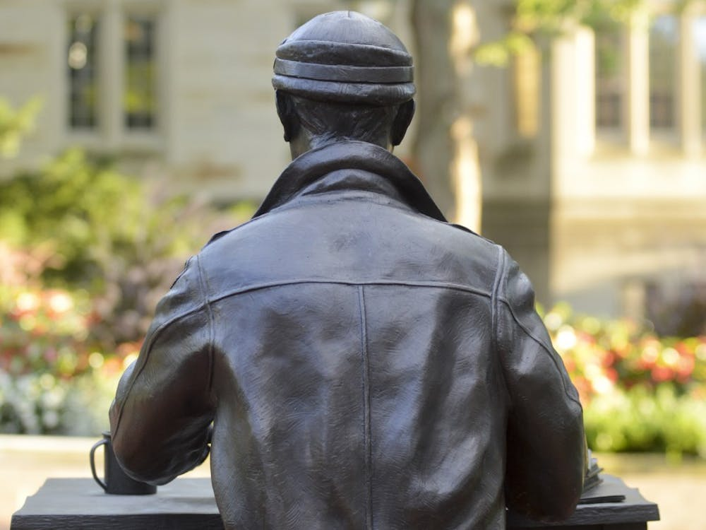 Pulitzer Prize-winning journalist Ernie Pyle sits at his typewriter outside of Franklin Hall, home of the Media School.
