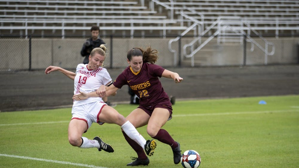 Senior Chandra Davidson attempts to reach for the ball as Minnesota sophomore Alana Dressely blocks it Oct 4. at Bill Armstrong Stadium. IU has a chance to climb up the Big Ten standings this weekend with home matches against Penn State and Ohio State.