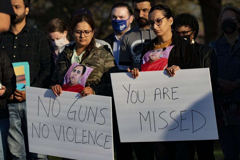 """<p>Attendees of a vigil in honor of those killed April 15 at the FedEx Groud shooting in Plainfield, Indiana,hold signs Saturday at Krannert Park in Indianapolis. &quot;You are missed,"""" and """"No guns, no violence,"""" the signs read.</p>"""