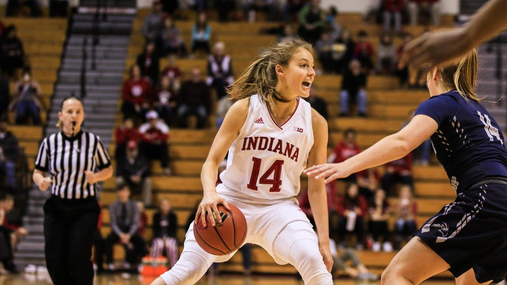 Then-junior guard Ali Patberg searches for a teammate to throw the ball to. No. 13 IU plays Samford University on Thursday night.