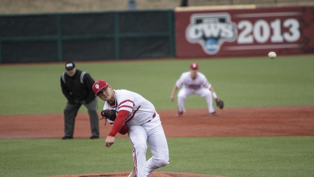 Junior left-hand specialist Andrew Saalfrank pitches the ball Feb. 27 at Bart Kaufman Field. Saalfrank replaced freshman right-hand specialist Gabe Bierman at the top of the fifth inning.