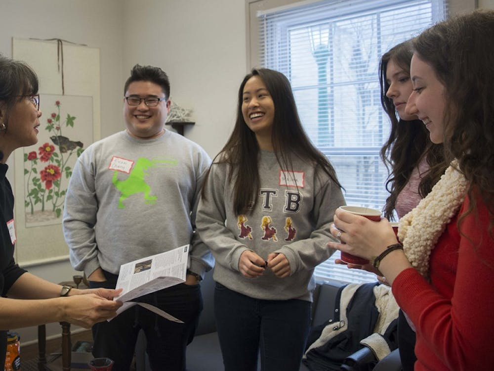Melanie Castill0-Cullather, director of Indiana University Asian Culture Center, talks to students before the workshop on how to honor and keep new year's resolutons at Asian Culture Center, Jan 13.
