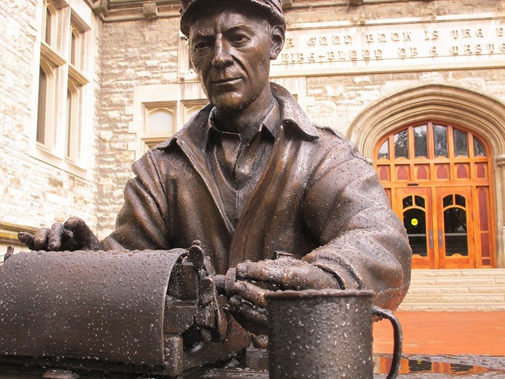 """A statue of alumnus and World War II correspondent Ernie Pyle typing on his typewriter was installed in front of Franklin Hall in 2014. According to """"Indiana University Bloomington: America's Legacy Campus,"""" the statue is meant to """"convey how Pyle worked alongside foot soldiers at the front during WW2."""""""