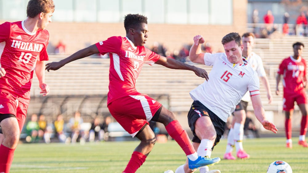 Then-sophomore forward Herbert Endeley fights for the ball on April 14, 2021, against Maryland in Bill Armstrong Stadium. IU men's soccer will face Butler University at 8 p.m. Aug. 31, 2021, in Bloomington.