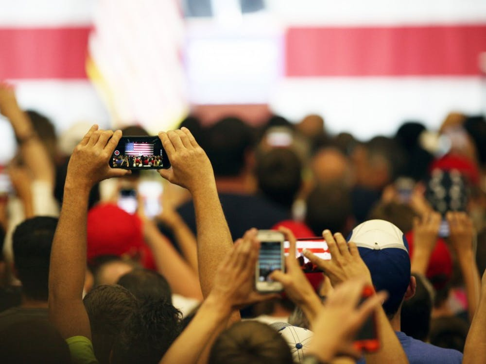 An audience member takes a picture as Donald Trump, republican presidential candidate, speak during a Trump rally in Westfield, Ind. on Tuesday evening.