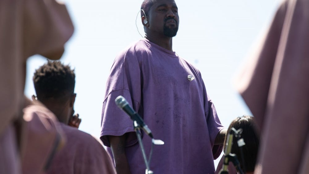 "Singer Kanye West stands during his Sunday service performance this past April at Coachella. West released his new album ""Jesus Is King"" on Oct. 25."