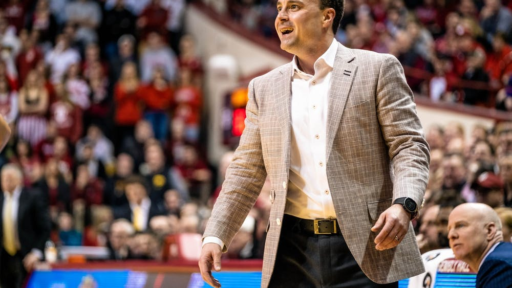 Head coach Archie Miller smiles Feb. 13 after IU gains a lead against Iowa in the first half of the game in Simon Skjodt Assembly Hall. IU was one of three schools 2021 four-star recruit Trey Patterson was considering attending.